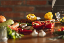 Close-up View Of Fresh Vegetables On Huge Wooden Table In Cafe, Restaurant Kitchen. Concept Of A Correct, Healthy Diet.