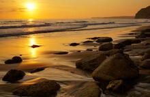 Sunset In Porto De Mos Algarve Portugal.