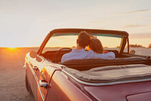 Luxury, Romantic Couple In Vintage Classic Cabriolet Car At Sunset