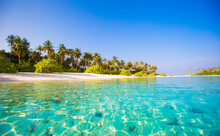 Beautiful Blue Water At A Tropical Beach Photo. Perfect White Beach With Turquoise Water At Ideal Island