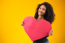 Attractive Afro Young Man Showing Red Heart On Yellow Background.