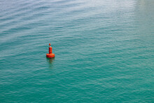 Single Red Buoy In The Clear Sea