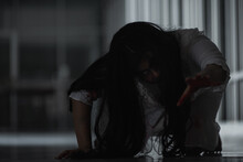 Horror Evil Woman Ghost Creepy Crawling Move Slowly Creeping Out In A Dark Room At House. Female Zombie In Blood Devil Is Scary She Haunted At The Abandoned Building, Happy Halloween Festival Concept
