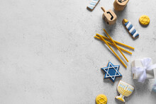 Tasty Cookies For Hanukkah Celebration With Candles And Dreidels On Grey Background
