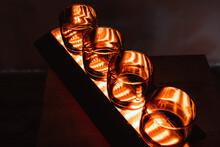4 Empty Dark Whiskey Glasses With A Bottom Warm LED Backlight