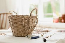 Wicker Basket Of Paper Vine On Table In Living Room