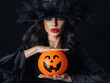 canvas print picture - Witch with Halloween pumpkin