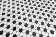Texture Of A Mosaic Floor Made Of Hexagonal Tiles In Black