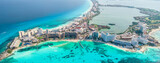 Fototapeta Kawa jest smaczna - Aerial panoramic view of Cancun beach and city hotel zone in Mexico. Caribbean coast landscape of Mexican resort with beach Playa Caracol and Kukulcan road. Riviera Maya in Quintana roo region on