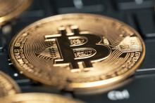 Golden Bitcoin Replica On Computer Keyboard