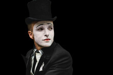 Portrait Of Elegant Expressive Male Mime Artist Posing On Black Background. Close-up Portrait Of A Male Mime Artist. Halloween Costume.