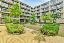 Inner Courtyard Of Apartment Building In Residential District