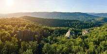 Panoramic View Of Bright Landscape With Green Forest Trees And Big Rocky Boulders Between Dense Woods In Summer. Beautiful Scenery Of Wild Woodland.