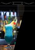 Composition of white frame over blue drink in bar on black background