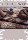 Composition of craft fair text and yarns on grey background