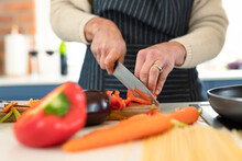 Close Up Of Senior Caucasian Woman In Kitchen Wearing Apron Cooking