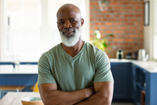 Portrait Of Happy Senior African American Man In Kitchen Looking At Camera