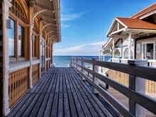 Beautiful Wooden House With Wooden Fence On The Sea