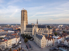 Aerial Drone Shot Of Mechelen Saint Rumbold's Cathedral Sint Rombouts Toren In A Lovely Morning Light While Birds Are Flying Around