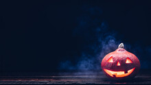 Halloween Pumpkin Jack O Lantern In Smoke On Old Wooden Planks