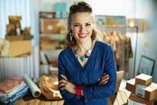 Smiling Business Owner Woman In Office In Blue Overall