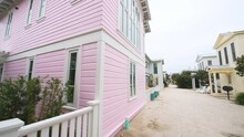 Pov Point Of View Walking In Seaside, Florida By Pink Beach Wooden Architecture House Property With Path Alley And Bicycle Bike Rack On Porch