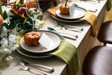 Fototapeta Kawa jest smaczna - Autumn table setting with fresh pumpkins in room