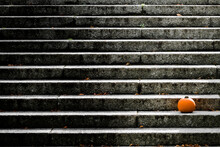 Orange Pumpkin On The Black And White Stairs