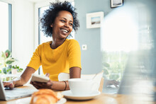 Happy Businesswoman Looking Away While Working At Home Office