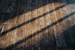 canvas print picture - Alter Dielenboden mit Schatten von der Sonne.
