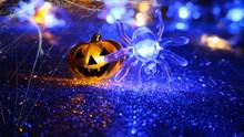 Dark Abstract Halloween Background. Funny Lantern Pumpkin, Spider Web, Blurred Bokeh.
