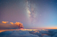 Milky Way And Volcano Smoke Over A Sea Of Clouds