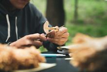 Person Cutting Mushroom In Nature