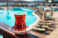 Hot Black Turkish Tea. Cups Of Turkish Tea With A Saucer On A Summer Background.