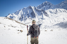 Traveler With Backpack Exploring Snowy Mountains
