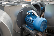 Batch Of Industrial Exhaust Snail Fans With Installed Electric Motors For Air Ventilation In A Factory Open-air Warehouse Storage Area Awaiting Transportation.