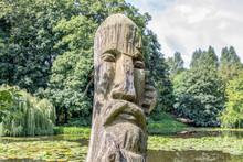 Wooden Sculptures Of Men In The Park