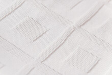 White Knitted Plaid On The Bed, Top View