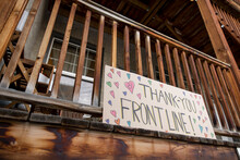Sign With Hearts Thanking Frontline Workers On Apartment Balcony