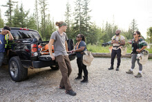 Conservation Volunteers Loading Equipment Into Pickup Truck