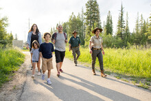 Rangers Leading Family On Nature Walk In Forest