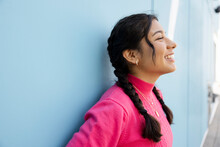 Close Up Of Cheerful Teenage Girl With Braids