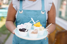 Close Up Of Ice Cream Variety On Tray In Girl's Hands