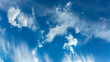 Blue Sky With Small Cumulus Clouds Against The Backdrop Of Scattered Cirrus Clouds As A Natural Background