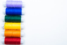 Skeins With Threads Are Lined Up In A Row According To The Color Of The Rainbow. Top View, Flat Lay, Copy Space, Isolate