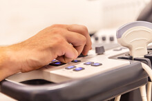 Fokus On A Doctor´s Hand Handling The Ultra Sonic Machine During An Examination