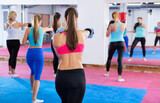Sporty positive women are training box in gym.