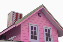 The Pink Triangular Roof And Red Chimney Have Small Solar Panels Attached To It.