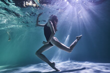 Fashion Girl Posing In The Pool Underwater