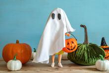 Halloween Decoration Ideas. Halloween Pumpkins, Ghost Doll Over Wooden Background.